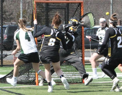 Lakeland/Panas goalie Miranda Lopes deflects Alex Meola's (No. 4) shot wide during March 23, 2019 game at Brewster.