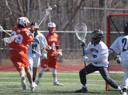 Huskers senior Dan O'Meara stopped 13 shots, including a bouncing attempt in the closing minutes as Yorktown defeated Mamaroneck 9-7 in a boys varsity lacrosse game at Yorktown High School March 23, 2019.