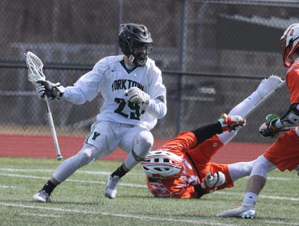 Yorktown defeated Mamaroneck 9-7 in a varsity lacrosse game at Yorktown High School March 23, 2019.