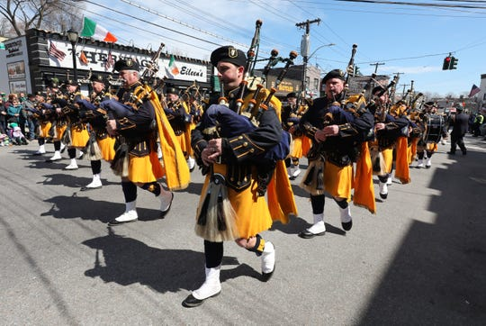 The Westchester County Police Emerald Society Pipes and Drums perform during the 64th annual Yonkers St. Patrick's Day Parade along McLean Avenue in the city, March 23, 2019.