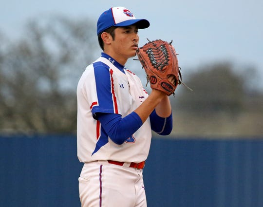 Graham's Luke Stone pitches against Burkburnett Friday, March 22, 2019, in Graham.