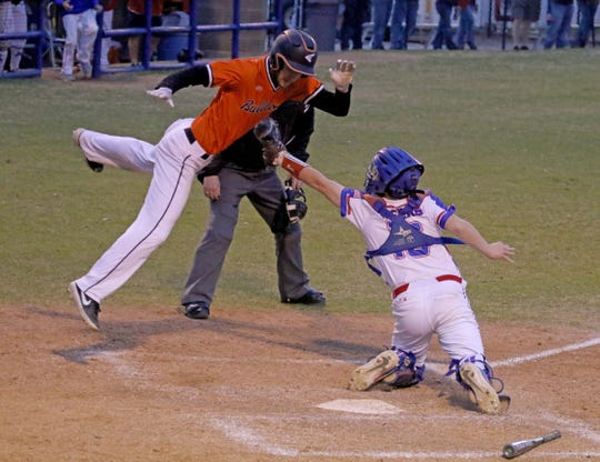 Burkburnett's Gavin Morris leaps to avoid the tags from Graham's Seth Shook and is called out Friday, March 22, 2019, in Graham.