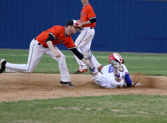 Burkburnett's Bladin Biner attempts the tag on Graham's Grant Bullock Friday, March 22, 2019, in Graham.