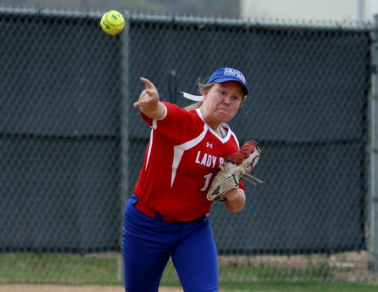Graham's Sarah Bundrick throws to first in the game against Burkburnett Friday, March 22, 2019, in Graham.