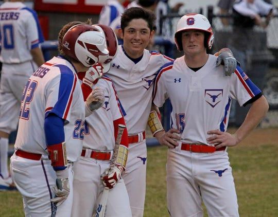 Graham's PArker Johnson, left, Corey Ballew, Luke Stone and Owen Loesch chat as Burkburnett's pitcher warms up Friday, March 22, 2019, in Graham.