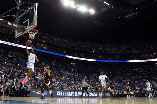 First round: North Carolina guard Coby White goes to the basket during the Tar Heels' win over the Iona Gaels.