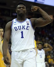 Zion Williamson flexes during Duke's first-round win over North Dakota State.