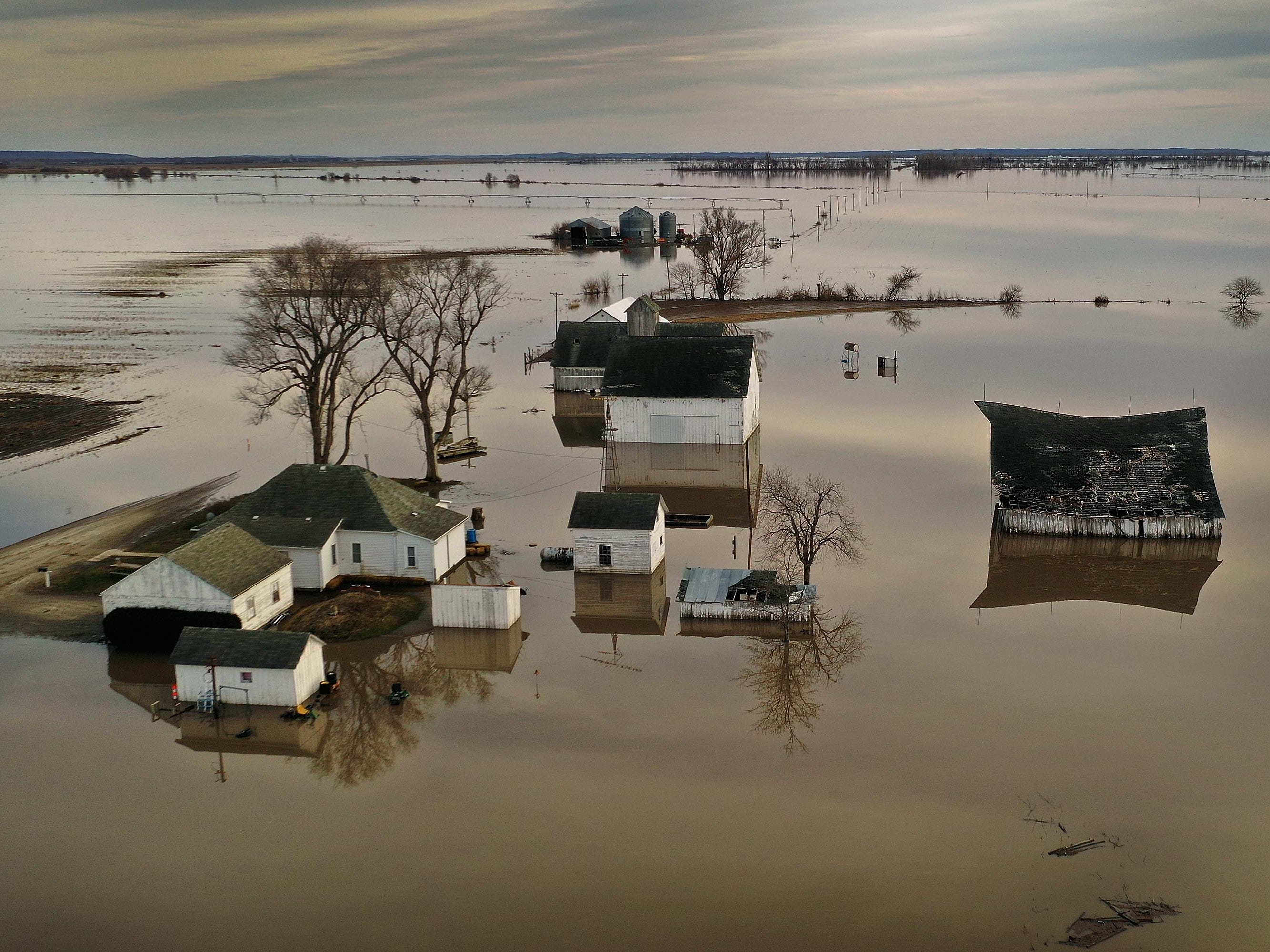 """Floodwater surrounds a farm on March 22, 2019 near Craig, Mo. Midwest states are battling some of the worst floodings they have experienced in decades as rain and snowmelt from the recent """"bomb cyclone"""" has inundated rivers and streams. At least three deaths have been linked to the flooding."""