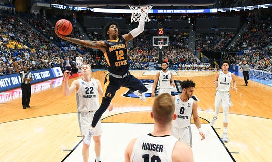 Murray State guard Ja Morant (12) dunks against Marquette during the first round of the 2019 NCAA tournament.