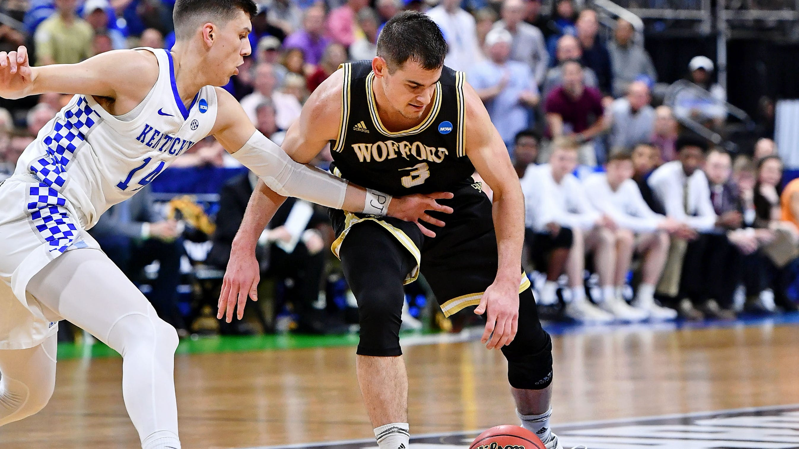 Wofford guard Fletcher Magee tries to dribble past Kentucky guard Tyler Herro during the second round of the 2019 NCAA tournament.