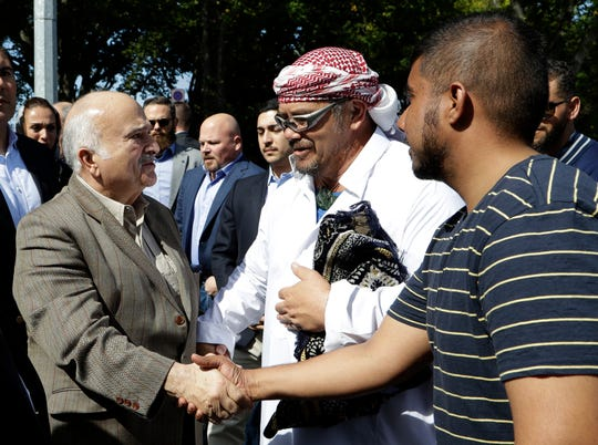 His Royal Highness Prince El Hassan bin Talal Hashemite (left) of the Kingdom of Jordan greets worshippers outside the Al Noor mosque in Christchurch, New Zealand.