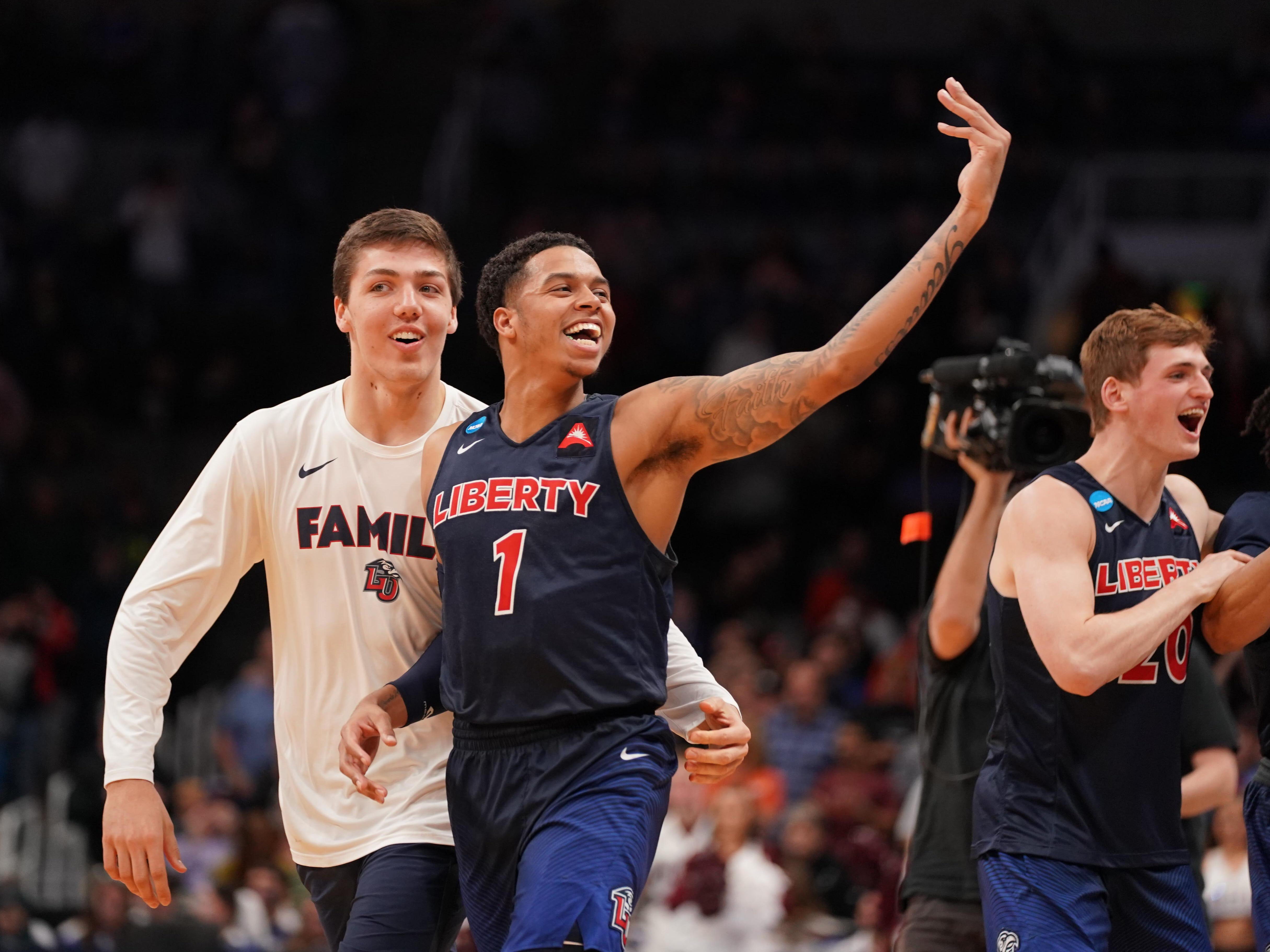 First round: Liberty guard Caleb Homesley (game-high) celebrates the Flames' upset of the No. 5 Mississippi State Bulldogs.