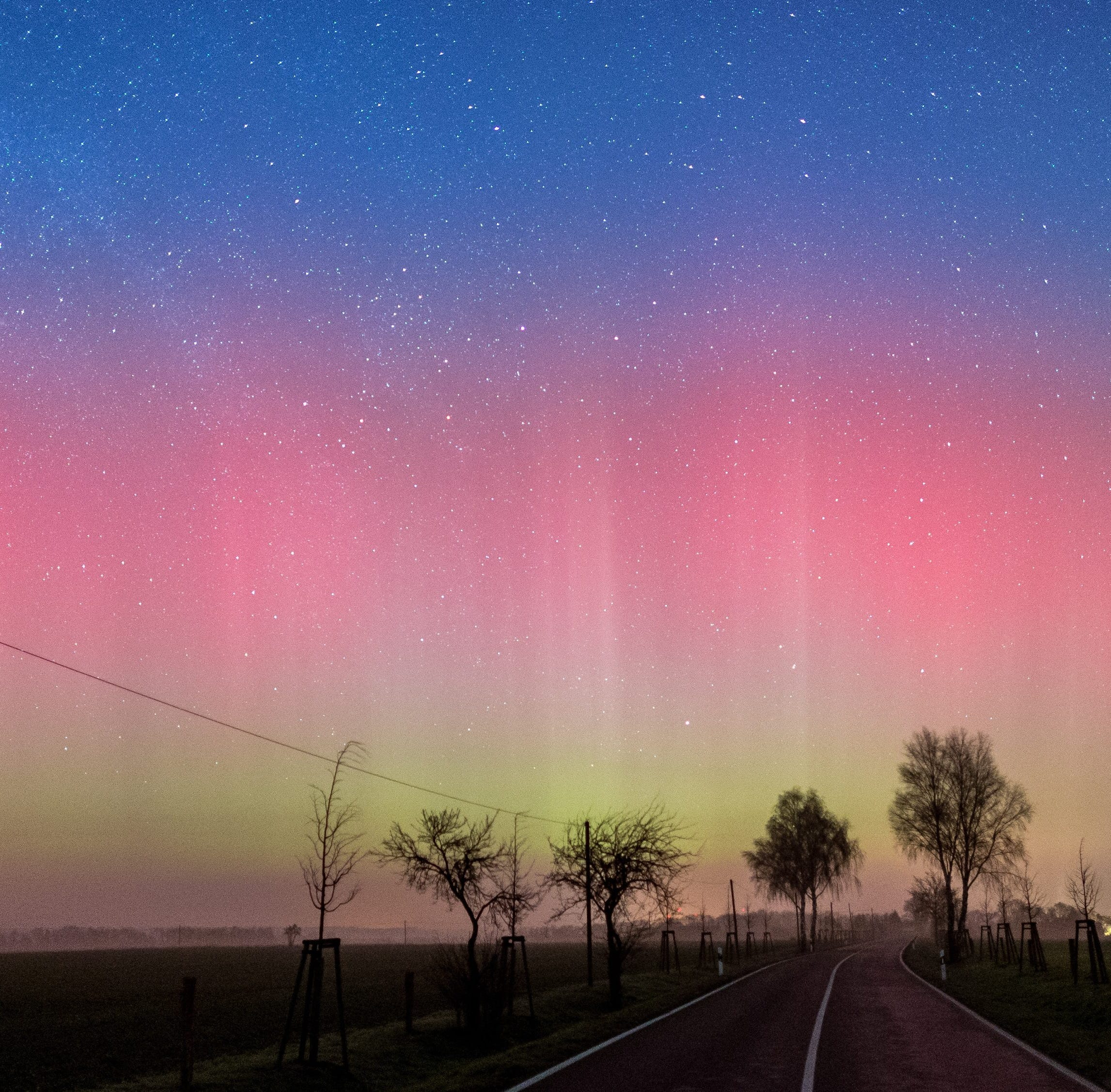 A long-time exposure of about 10 seconds shows a Northern Light (Aurora borealis) in the sky, near Lietzen, Brandenburg, Germany in this 2016 file photo. An unusually large burst of electrically charged particles from the sun on March 20 is stirring a geomagnetic storm this weekend that is expected to push the aurora into the upper tier of the U.S. on March 23, giving northern states a rare glimpse of the colorful phenomenon.