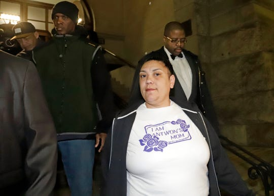 Michelle Kenney, center, the mother of Antwon Rose II, leaves the Allegheny County Courthouse with supporters after hearing the verdict of not guilty on all charges for Michael Rosfeld, a former police officer in East Pittsburgh, Pa., Friday, March 22, 2019.