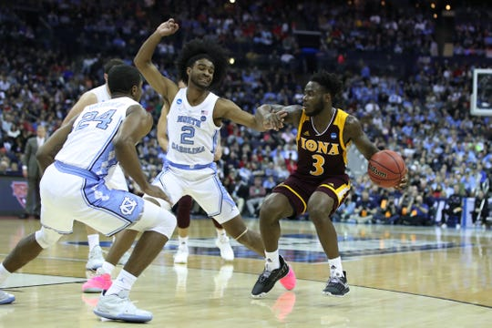 Iona Gaels guard Asante Gist (3) dribbles passed North Carolina Tar Heels guard Coby White (2)  in the first round of the 2019 NCAA Tournament at Nationwide Arena.
