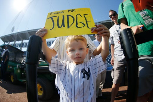 March 23: A young Yankees fan holds a sign up for Aaron Judge.