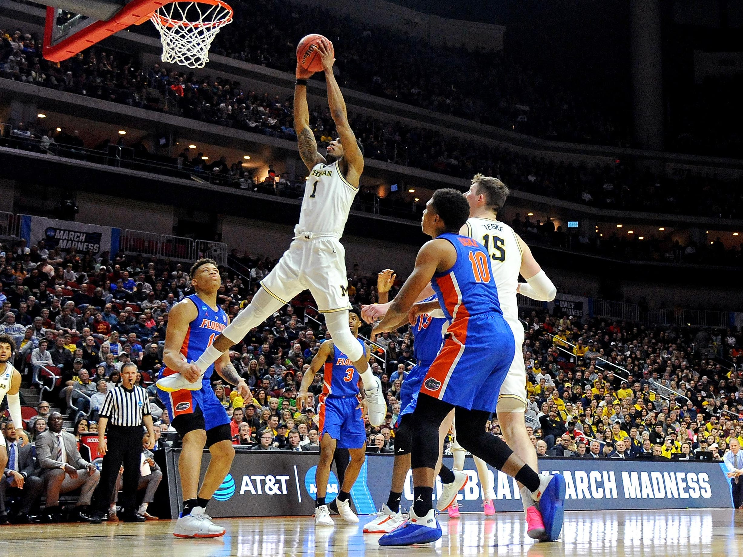 Round of 32: Michigan Wolverines guard Charles Matthews goes up for a dunk against the Florida Gators.