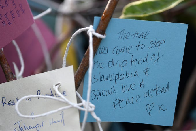 Members of the public attend a vigil in George Square to pay their respects for the victims of the Christchurch Mosque shootings in New Zealand on March 23, 2019 in Glasgow, Scotland. People from all faiths attended the event where they wrote symbolic messages of peace, love and unity before tying them to a tree of peace.