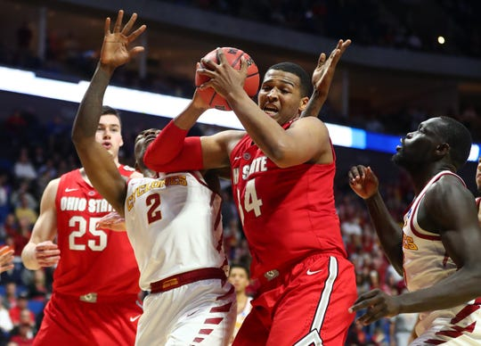 Ohio State Buckeyes forward Kaleb Wesson (34) grabs a rebound against Iowa State Cyclones forward Cameron Lard (2) and guard Marial Shayok (right).
