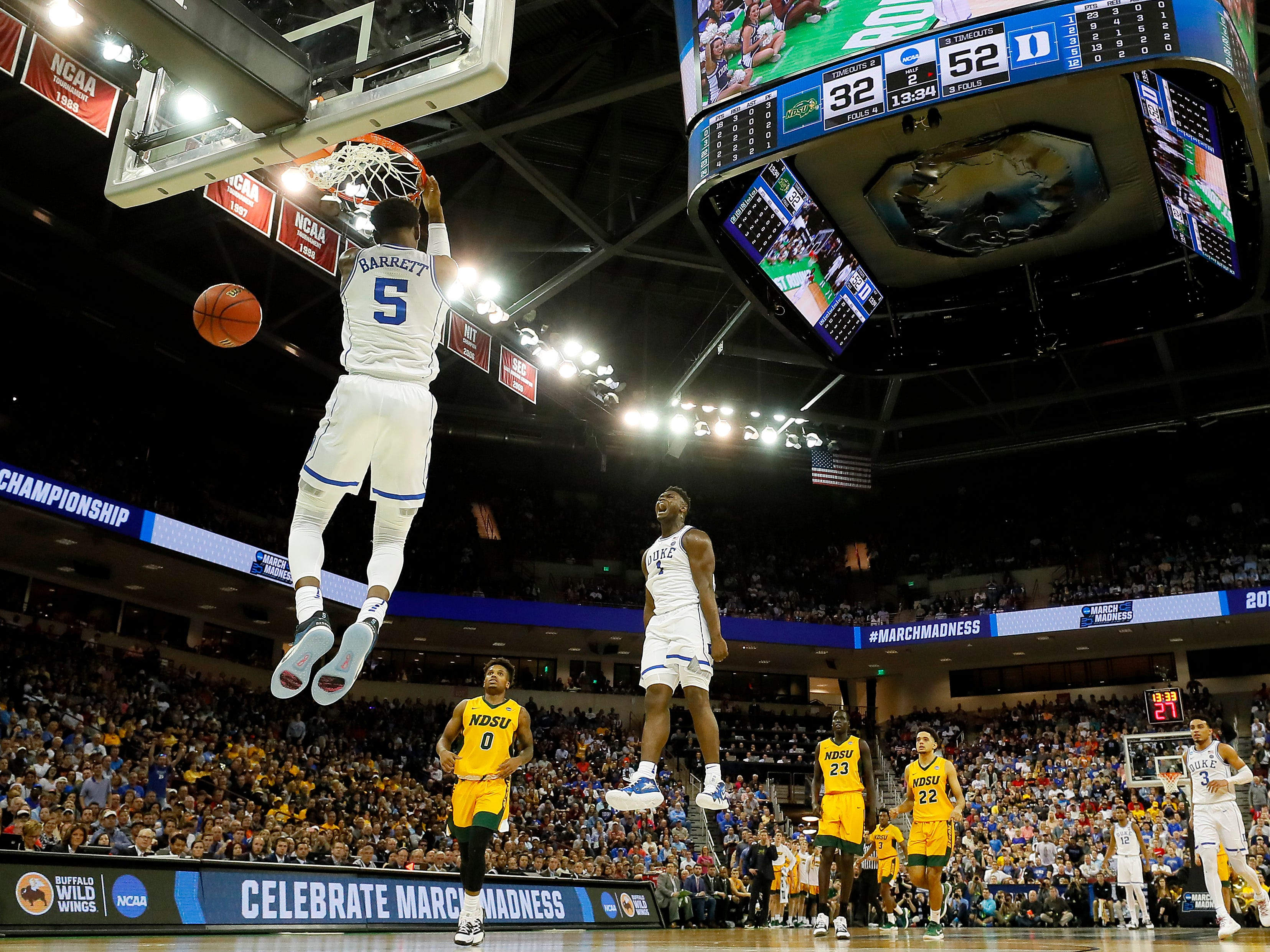 First round: RJ Barrett dunks as Zion Williamson celebrates during Duke's win over the North Dakota State Bison. The two freshmen combined for 51 points.