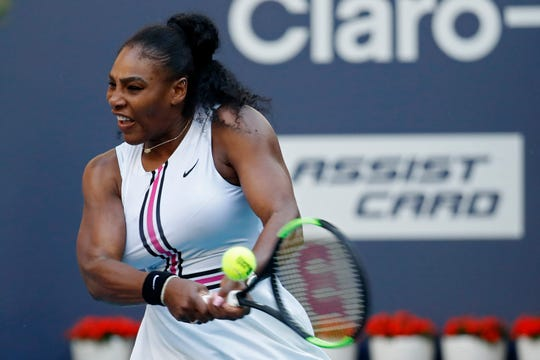 Serena Williams hits a backhand against Rebecca Peterson at the Miami Open.
