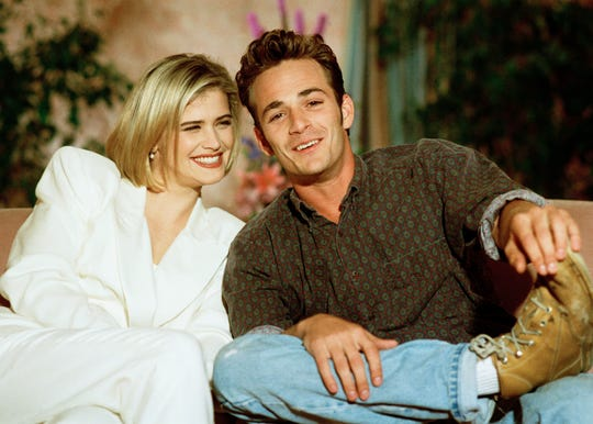 Kristy Swanson, left, and Luke Perry, viewed here in a 1992 photo, starred in a film version of 'Buffy the Vampire Slayer.' Perry died in early March.