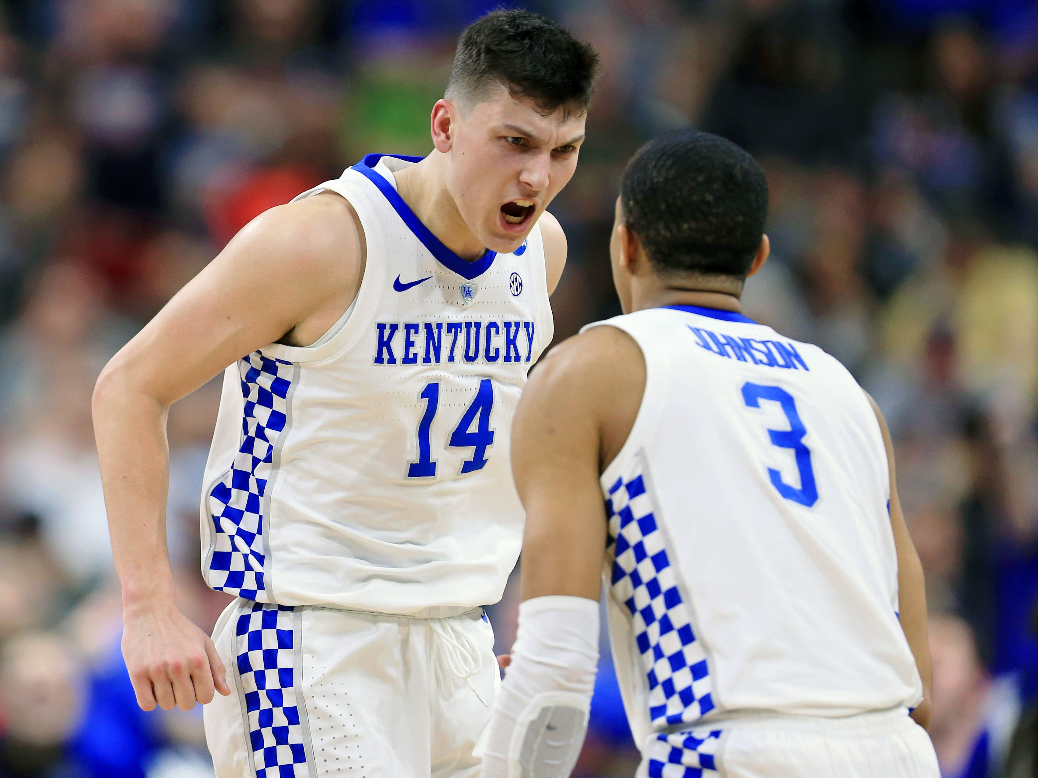 Kentucky's Tyler Herro (14) and guard Keldon Johnson celebrate during the Wildcats' 62-56 victory over Wofford in the second round of the NCAA Tournament.