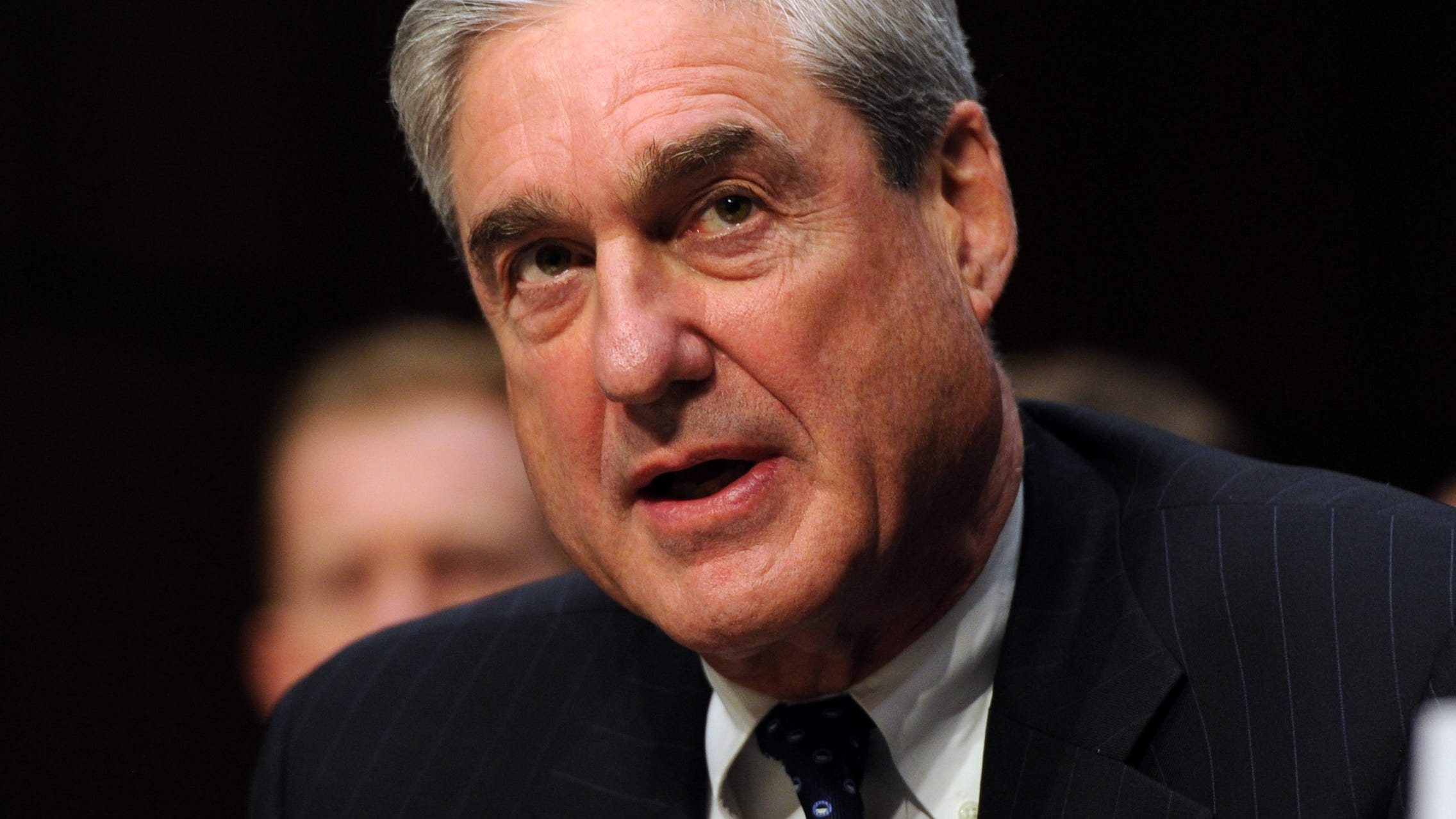 Former FBI Director Robert Mueller is pictured testifying at a Senate Intelligence Committee hearing on worldwide threats.