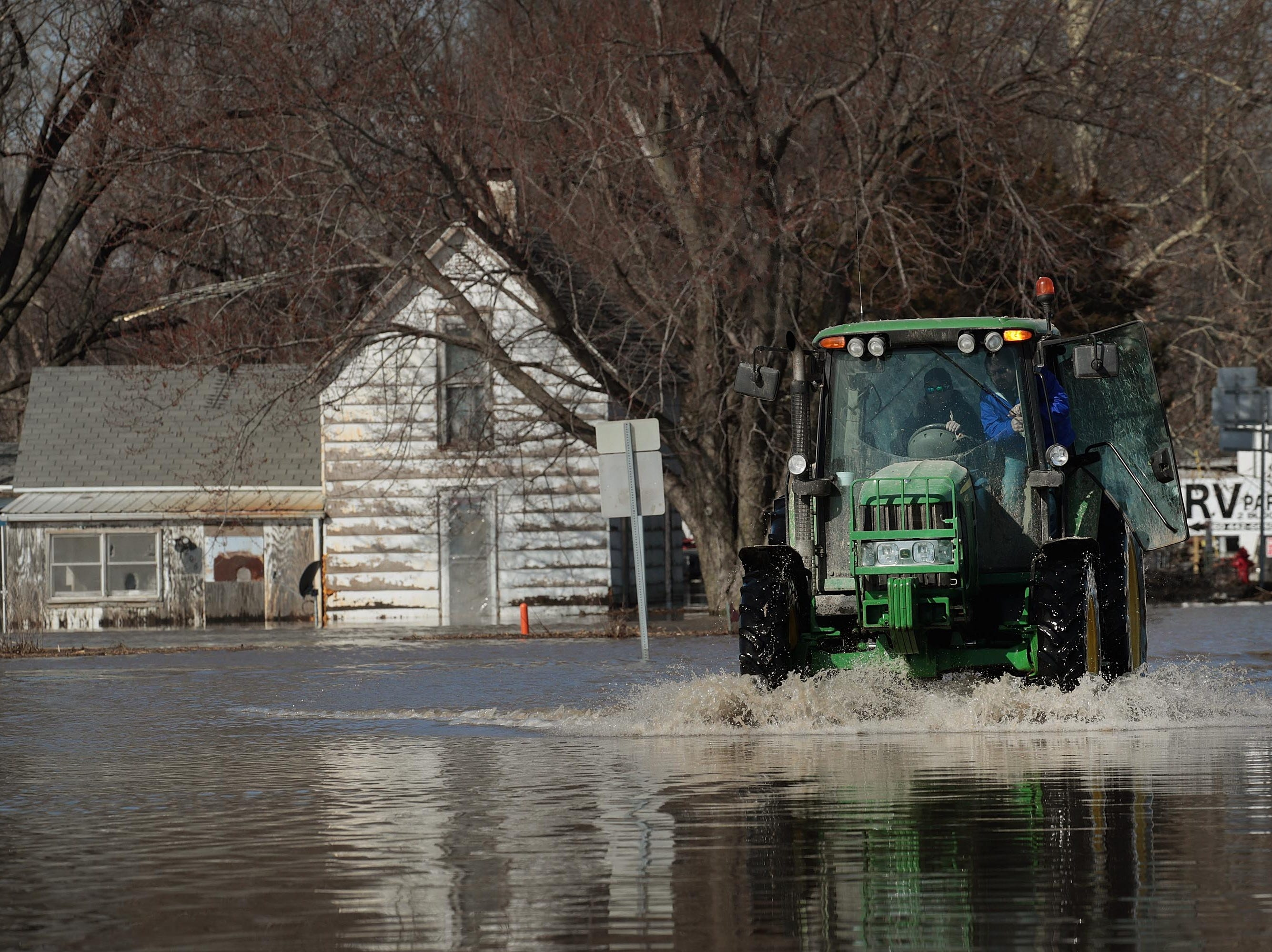 A tractor heads into town on Highway  59  on March 22, 2019 in Craig, Mo.