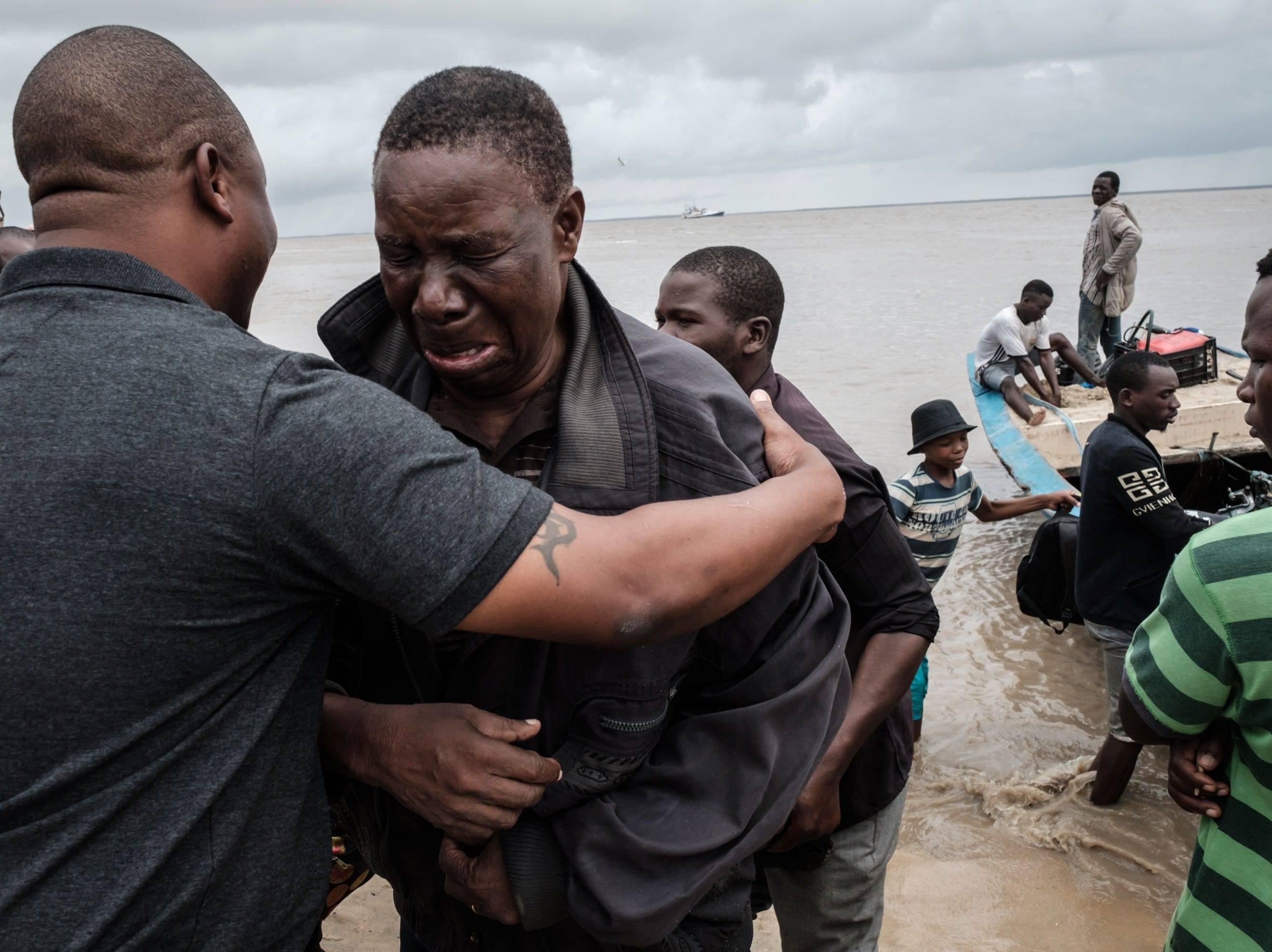 Manuel Machacawa Maezane, 76, cries as he meets his son Aristides, left, after being evacuated from Buzi, on the beach in Beira, Mozambique, on March 23, 2019. The death toll in Mozambique on March 23, 2019 climbed to 417 after a cyclone pummeled swathes of the southern African country, flooding thousands of square kilometers, as the UN stepped up calls for more help for survivors. Cyclone Idai smashed into the coast of central Mozambique last week, unleashing hurricane-force winds and rains that flooded the hinterland and drenched eastern Zimbabwe leaving a trail of destruction.