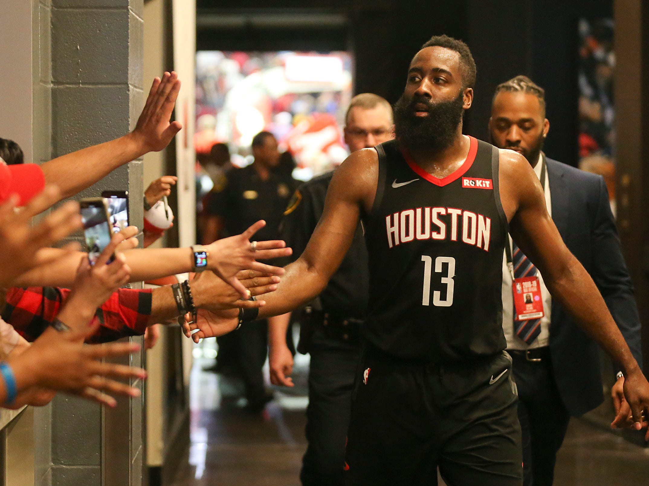 March 22: Rockets star James Harden celebrates with fans after tying his career high and franchise record with 61 points in a win over the Spurs.
