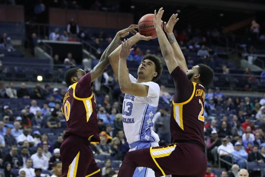 North Carolina guard Cameron Johnson  goes to the basket against the iona defense during the first round of the 2019 NCAA tournament.