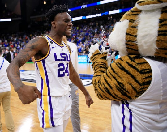 Round of 32: LSU forward Emmitt Williams celebrates the win over Maryland with the Tigers mascot.
