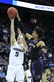 Washington guard Matisse Thybulle (4) blocks a shot from Utah State guard Sam Merrill in the first round of the 2019 NCAA Tournament.