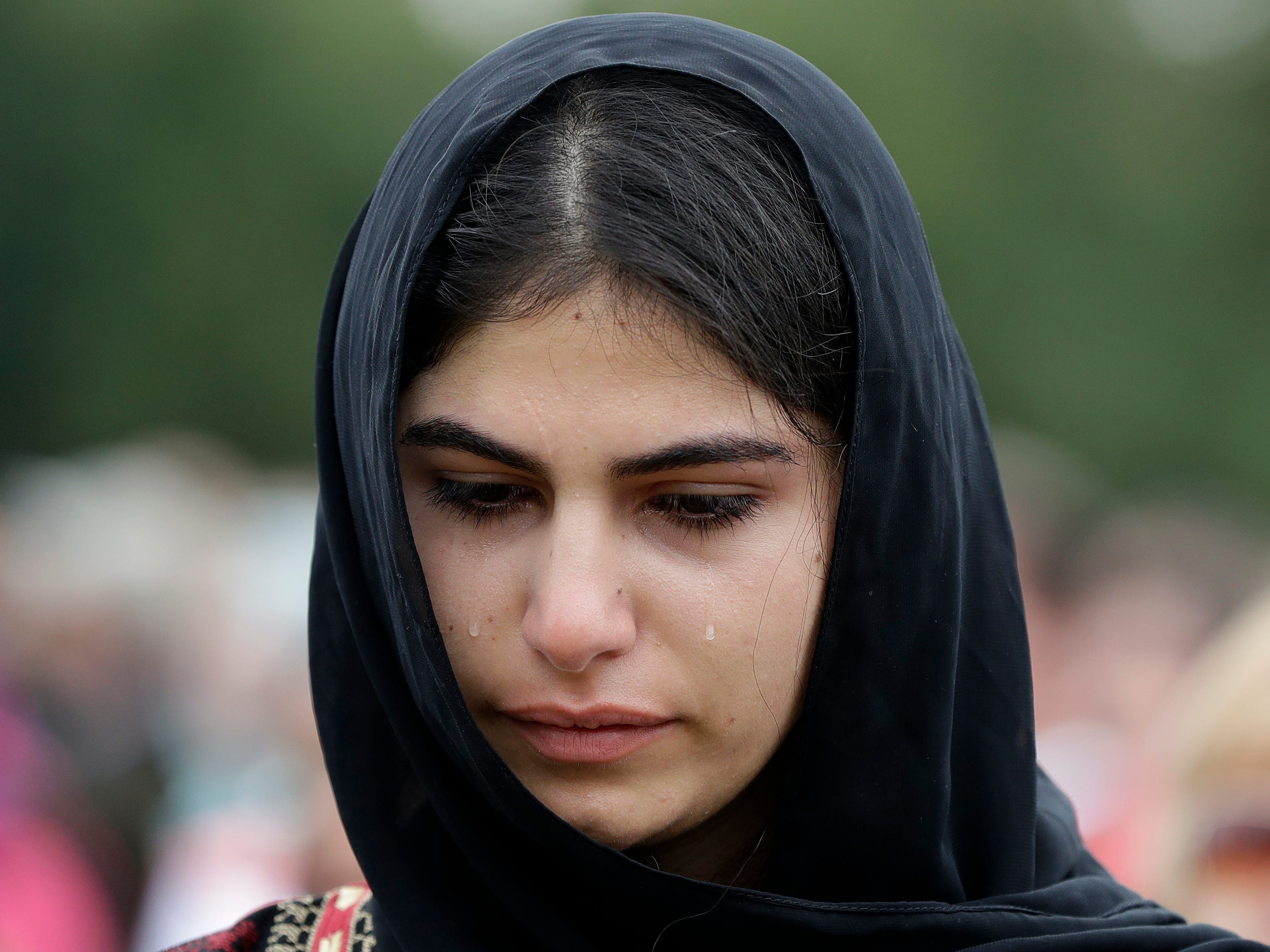 "A young muslim woman cries during a gathering for the ""March for Love"" in Hagley Park following last week's mosque attacks in Christchurch, New Zealand, Saturday, March 23, 2019."