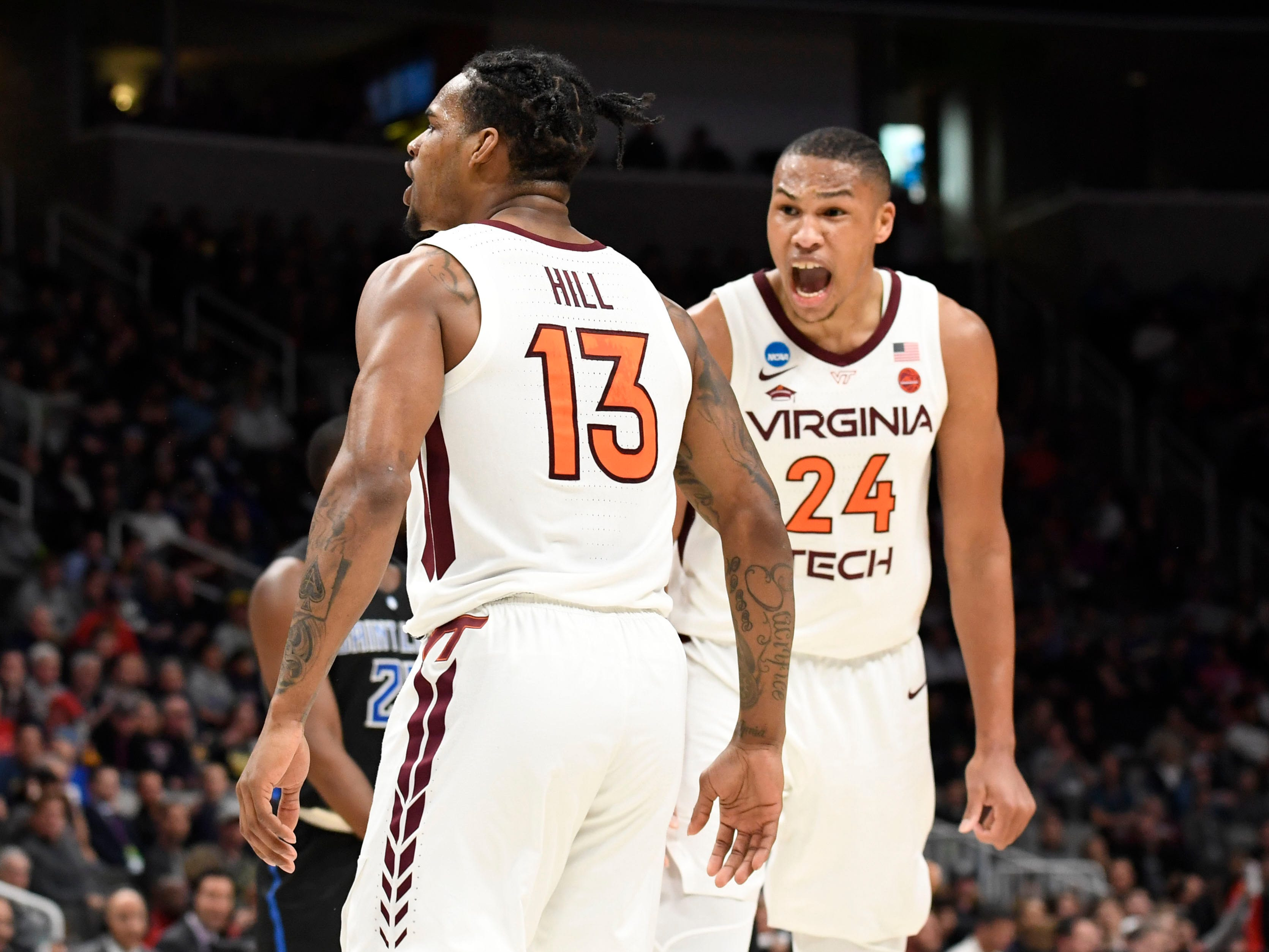 First round: Virginia Tech Hokies guard Ahmed Hill and forward Kerry Blackshear Jr. celebrate during their team's win over the Saint Louis Billikens.