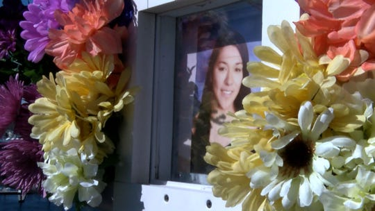 Flowers surround Sarah Stern's photo at the memorial on the Route 35 Southbound bridge over the Shark River that was decorated to mark her 22nd birthday Sunday, March 24, 2019.  Liam McAtasney and Preston Taylor will face sentencing in May for her murder and throwing her off the bridge into the river at this spot.