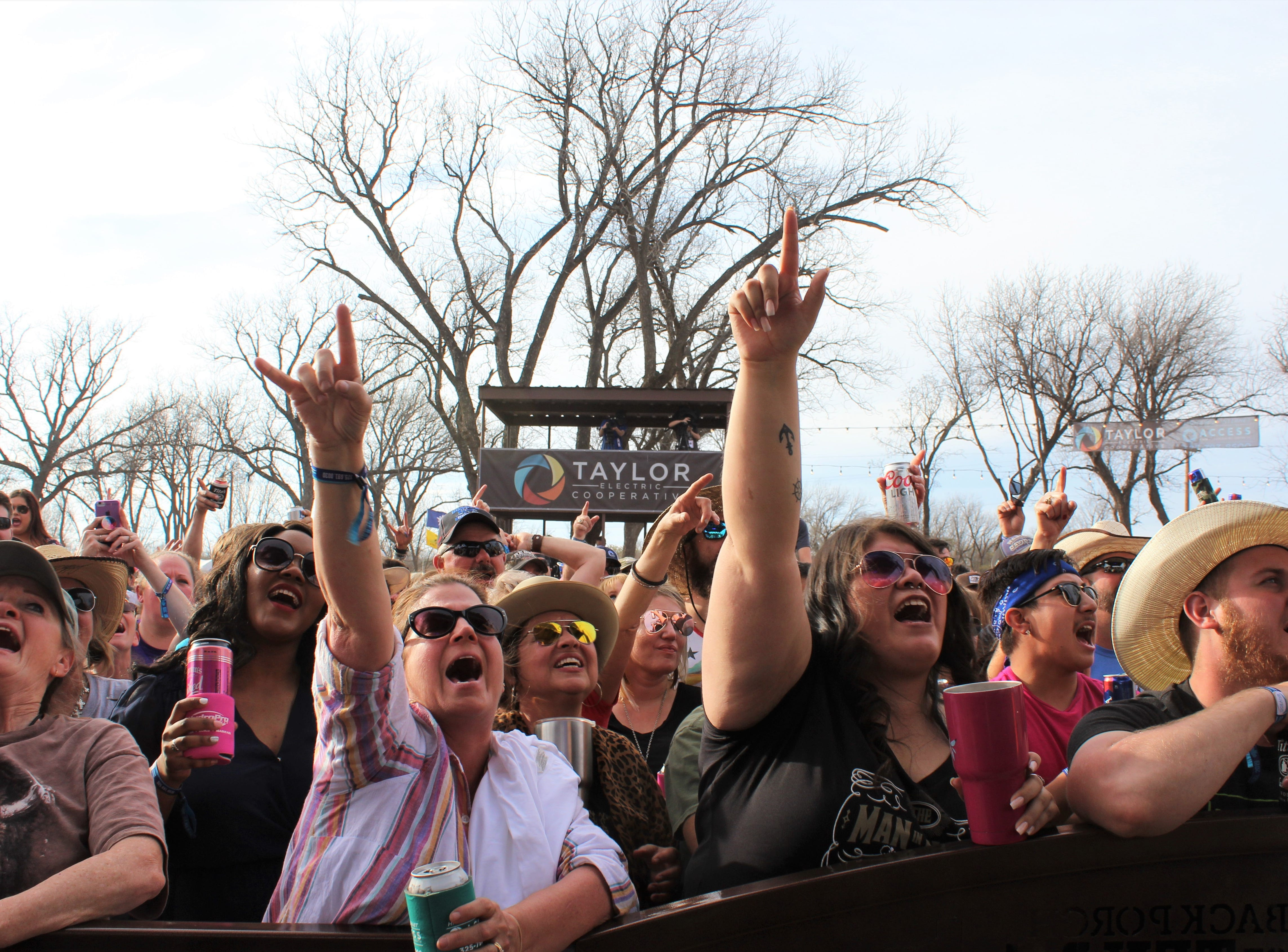 Kevin Fowler fans react to their singer's set Saturday afternoon March 23, 2019, at the 9th Outlaws & Legends Music Festival.