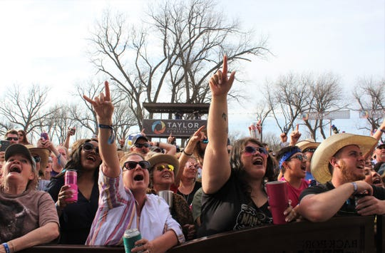 Kevin Fowler fans react to their singer's set Saturday afternoon at the 9th Outlaws & Legends Music Festival.