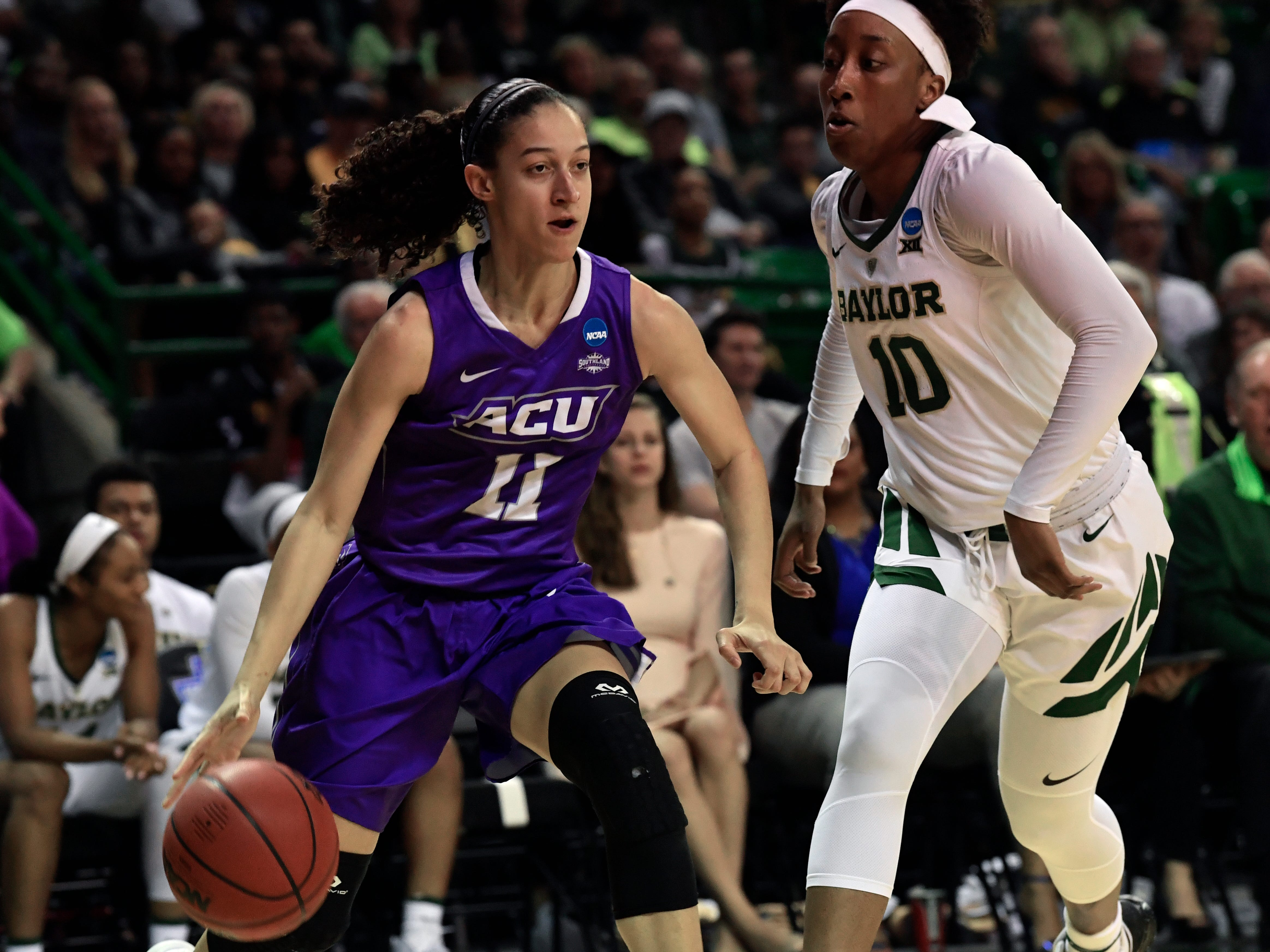ACU guard Sara Williamson drives past Baylor forward Aquira DeCosta to the net during Saturday's NCAA Tournament women's round 1 basketball game March 23, 2019. Baylor defeated Abilene Christian University, 95-38.
