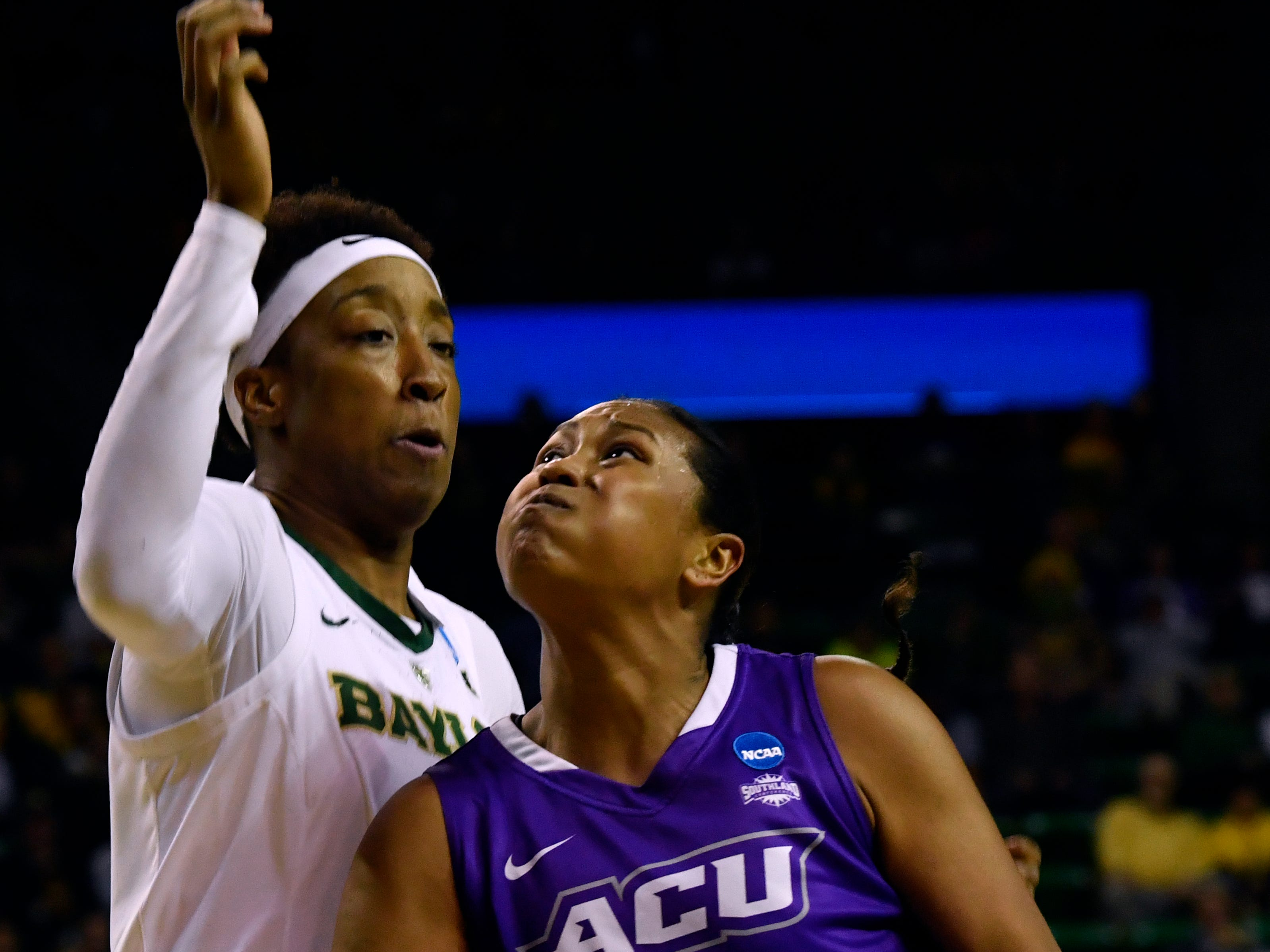 ACU forward Dominque Golightly shoulders Baylor forward Aquira DeCosta during Saturday's NCAA Tournament women's round 1 basketball game March 23, 2019. Baylor defeated Abilene Christian University, 95-38.