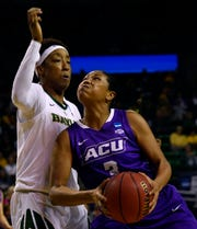 ACU forward Dominque Golightly drives against Baylor forward Aquira DeCosta during first-round NCAA Tournament game March 23 in Waco. Baylor won 95-38.