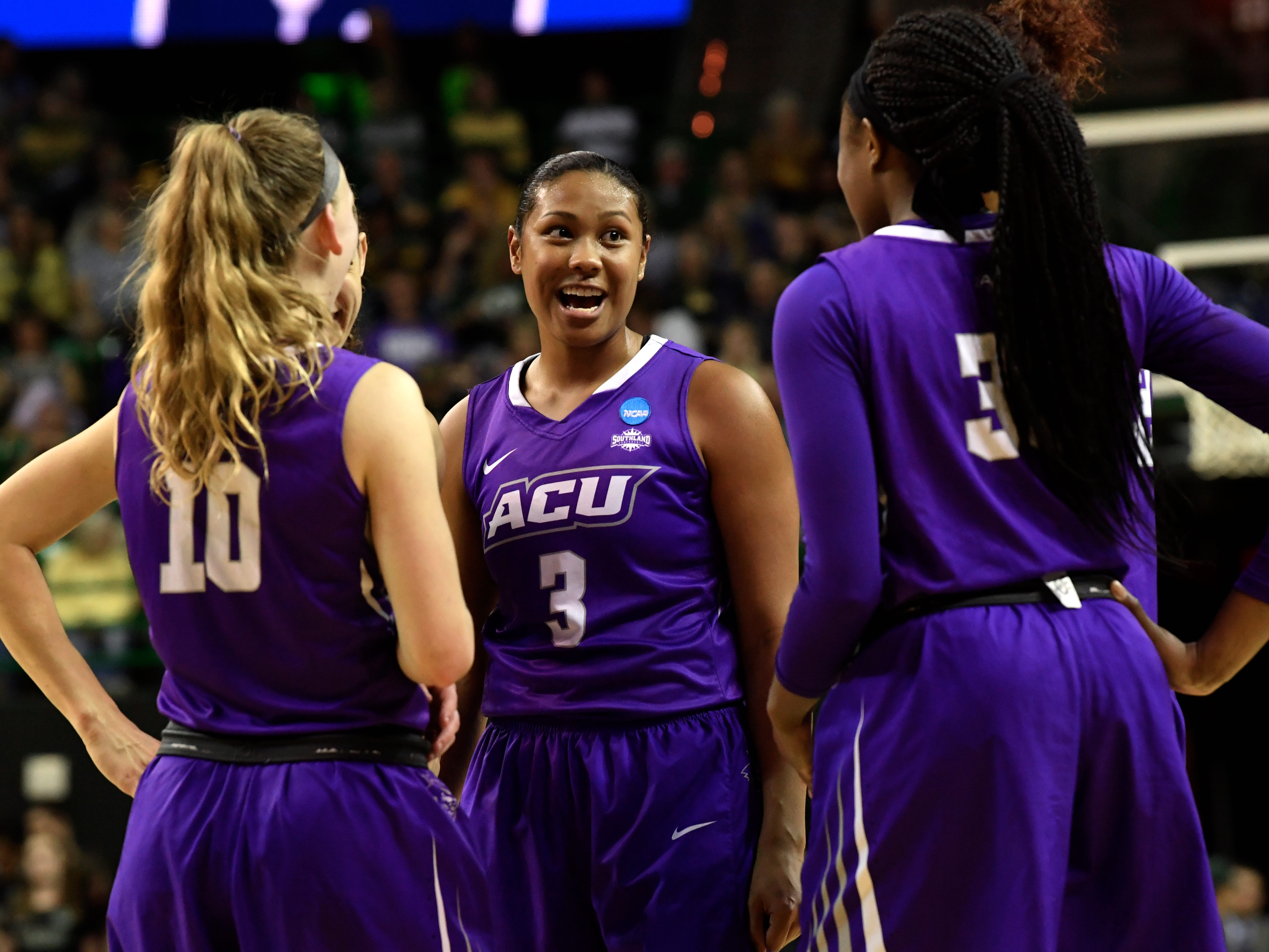 ACU forward Domique Golightly chats with teammates Breanna Wright (left) and Alyssa Adams during a timeout at Saturday's NCAA Tournament women's round 1 basketball game March 23, 2019. Baylor defeated Abilene Christian University, 95-38.