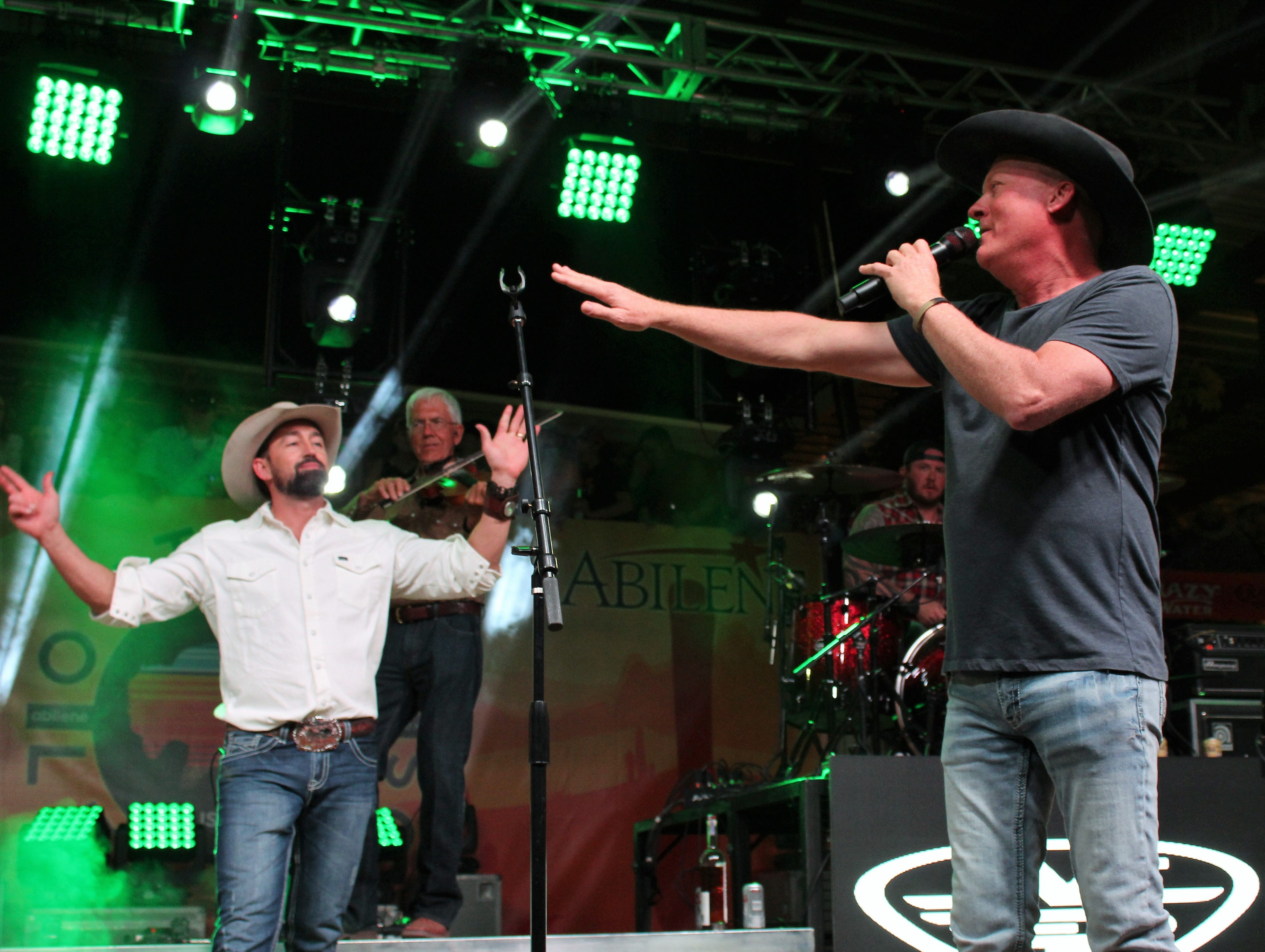 Kevin Fowler stops the band because, he said, he messed up the lyrics while dueting with Mark Powell at Saturday's Outlaws & Legends Music Festival March 23, 2019.