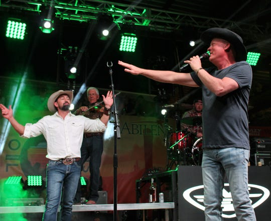 Mark Powell, left, and Kevin Fowler joke on stage at a previous Outlaws & Legends Music Festival. Both were to perform at this year's two-day event, canceled due to coronavirus concerns.
