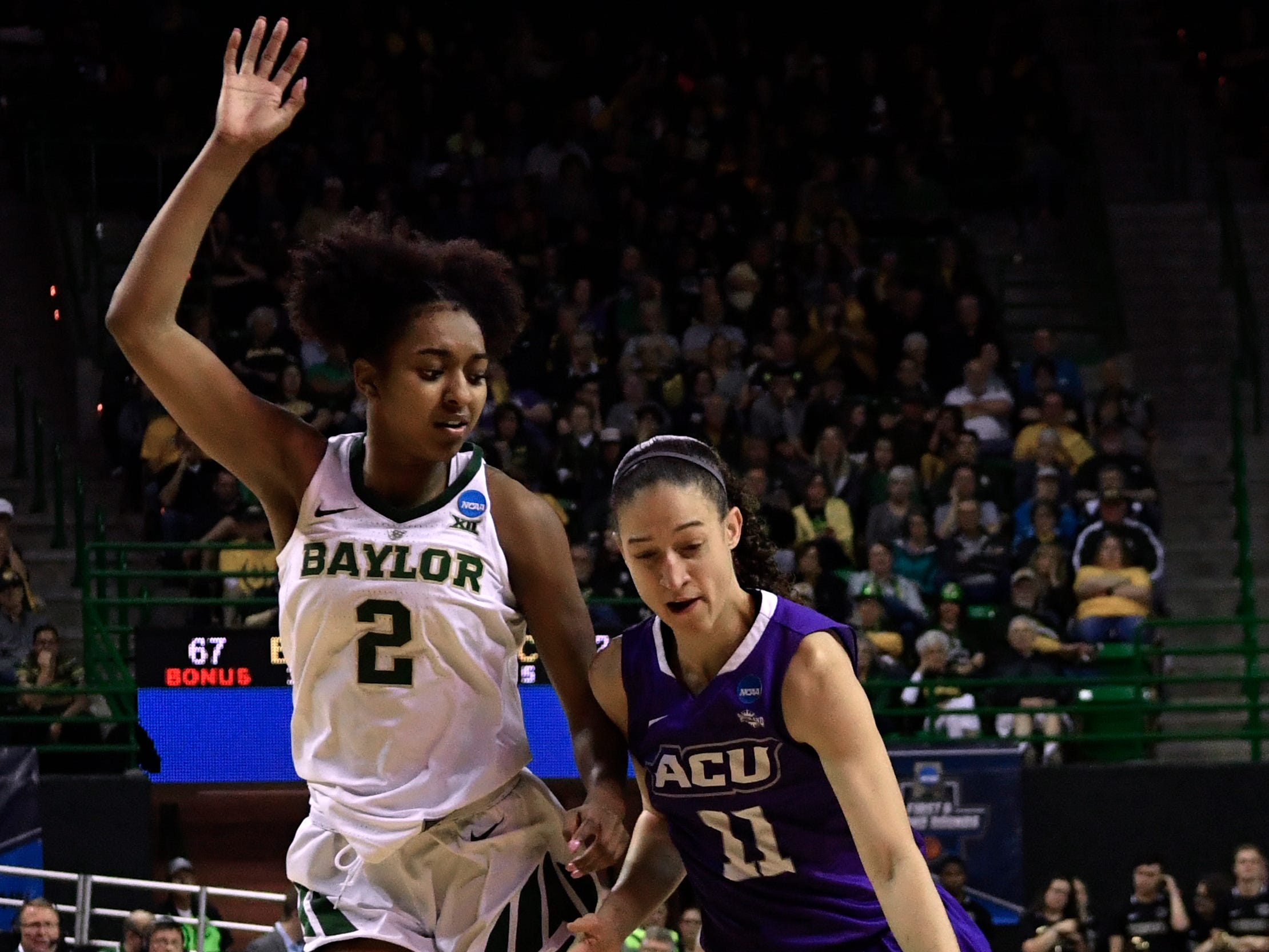 ACU's Sara Williamson is guarded by Baylor's Didi Richards during Saturday's NCAA Tournament women's round 1 basketball game March 23, 2019. Baylor defeated Abilene Christian University, 95-38.