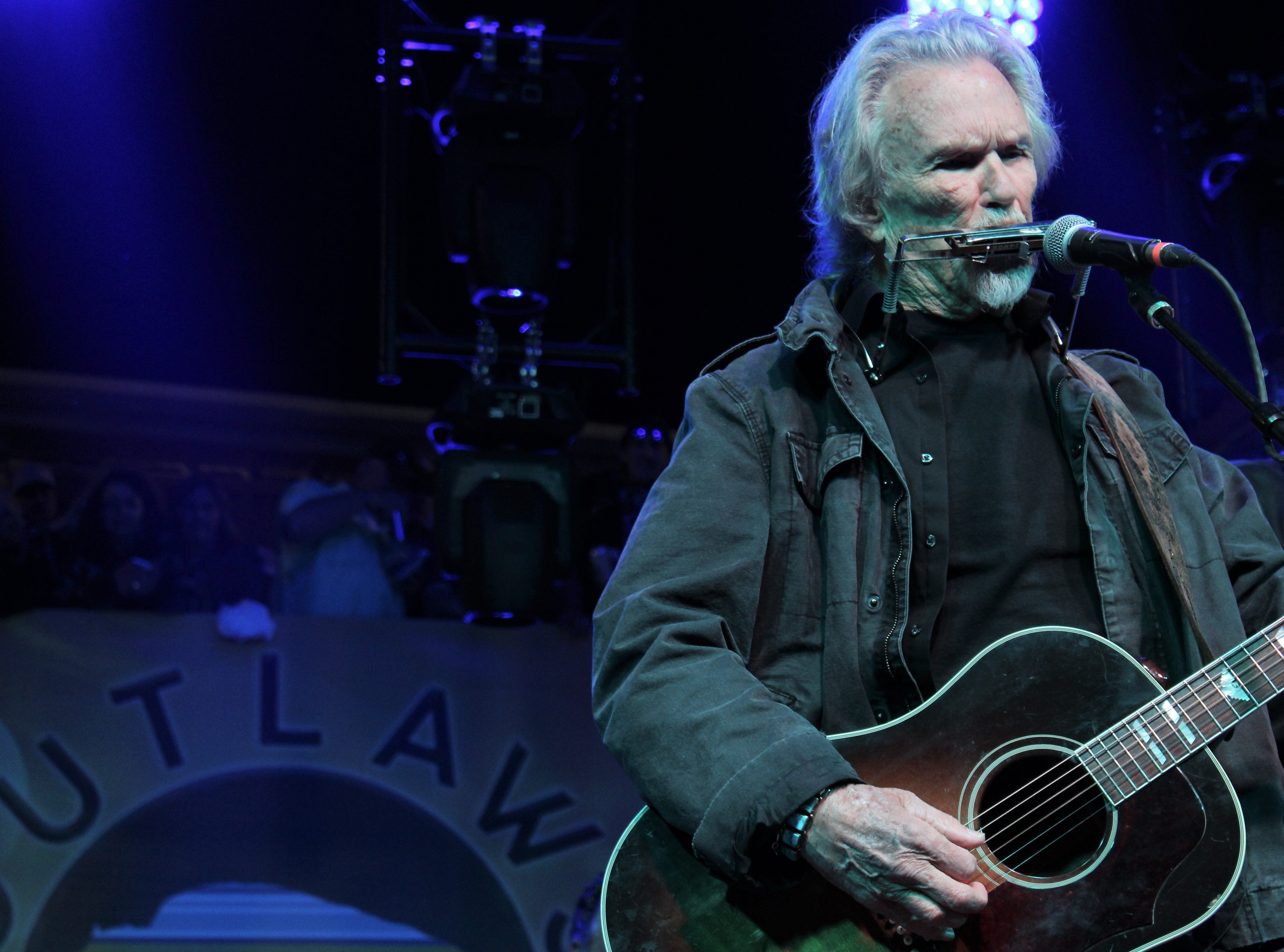 Kris Kristofferson plays the harmonica at Saturday's Outlaws & Legends Music Festival March 23, 2019.