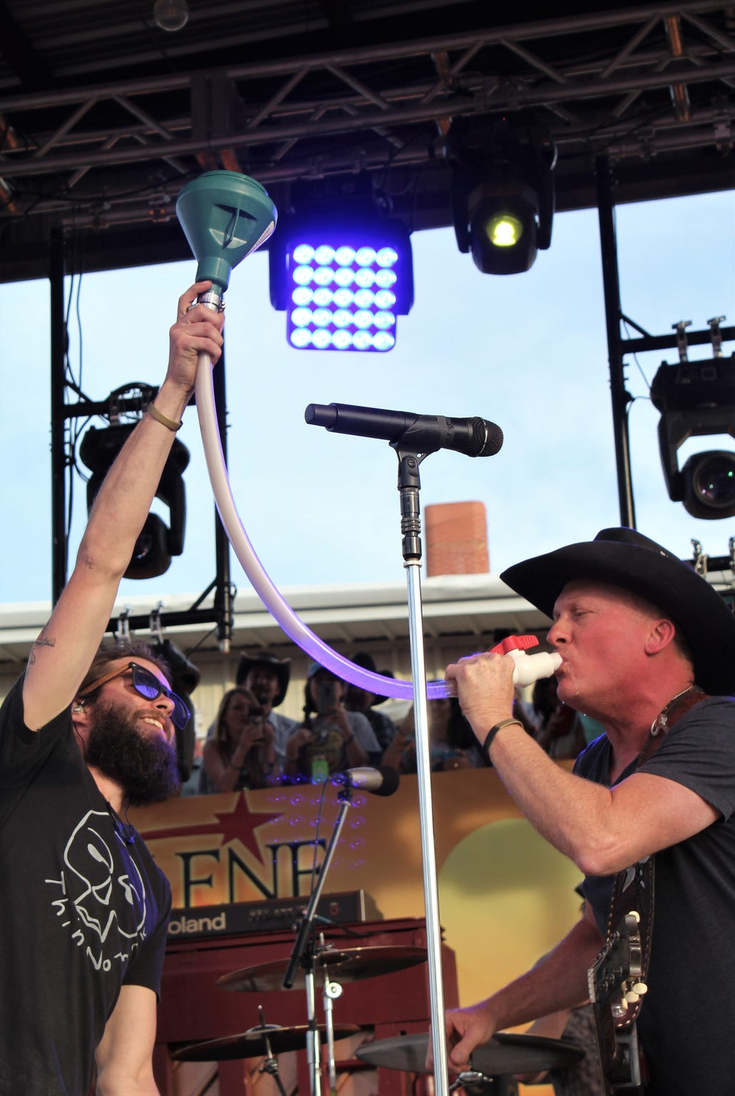 Kevin Fowler guzzles a beer during his 2019 set at the Outlaws & Legends Music Fest.