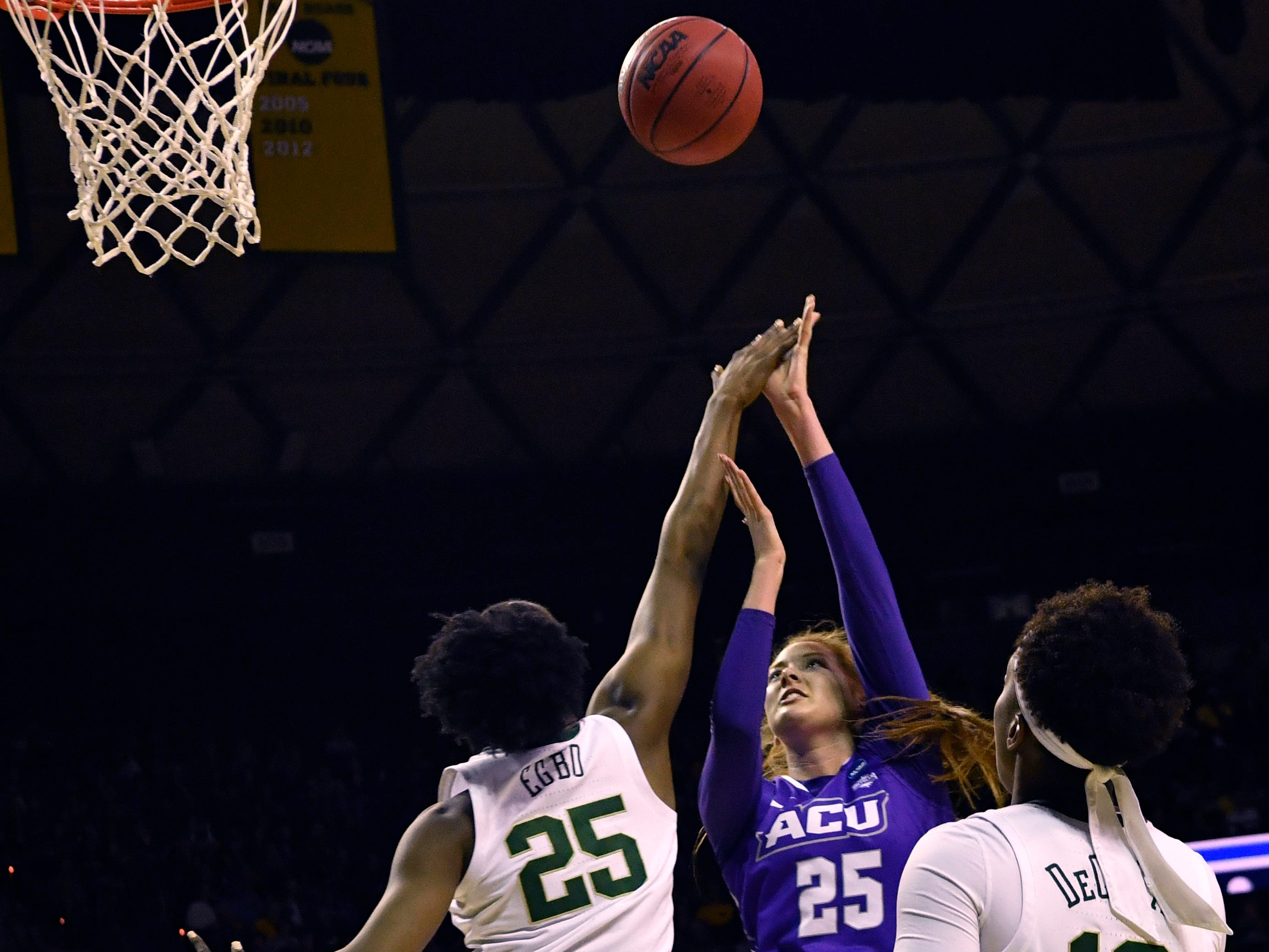 ACU's Lexi Kirgan tries for a basket past Baylor's Queen Egbo during Saturday's NCAA Tournament women's round 1 basketball game March 23, 2019. Baylor defeated Abilene Christian University, 95-38.