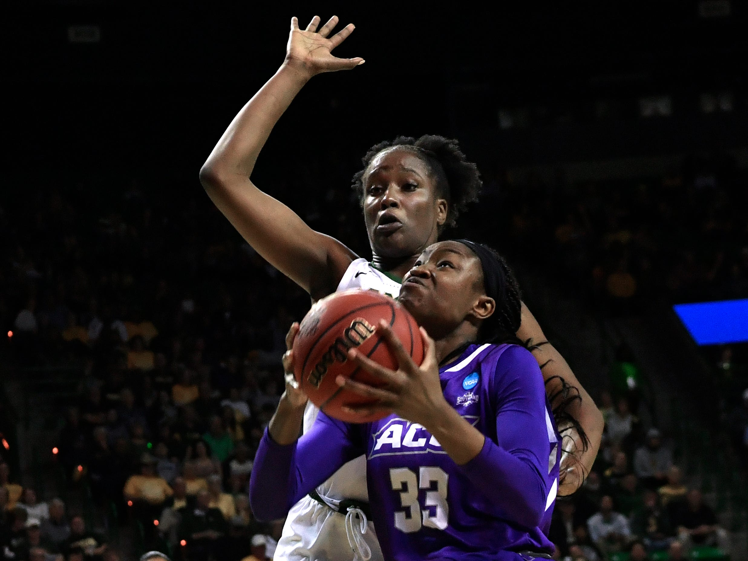 ACU's Alyssa Adams tries for a basket against Baylor's Queen Egbo during Saturday's NCAA Tournament women's round 1 basketball game March 23, 2019. Baylor defeated Abilene Christian University, 95-38.